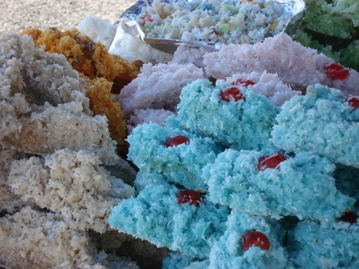 Bonbon coco is a popular Malagasi candy made from shredded coconut cooked with caramelized sugar and formed into chewy balls or patties.
