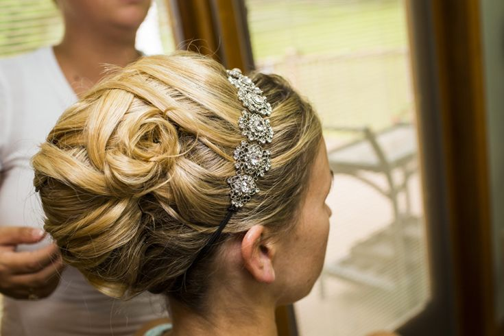 Classic wedding updo for the bride with glitzy headband (Michael Chadwick Photography)