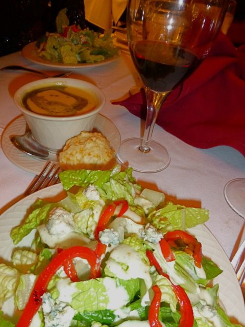 Roasted butternut squash soup and hearts of romaine salad with red ...