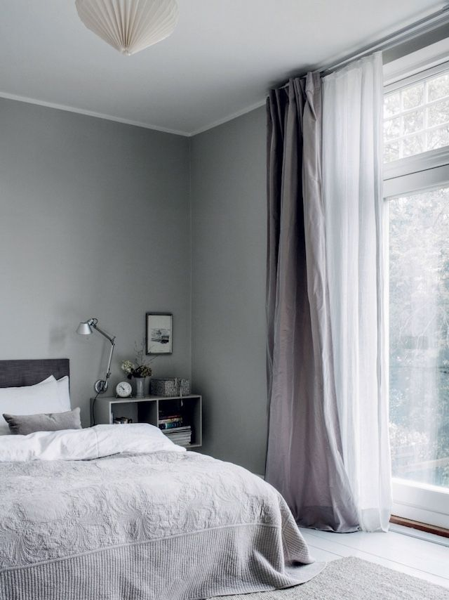 gray, floor to ceiling drapes/windows.