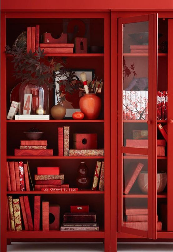 Red bookcase and decor from Wandering the Good -- sunflowersandsearchinghearts.tumblr.com