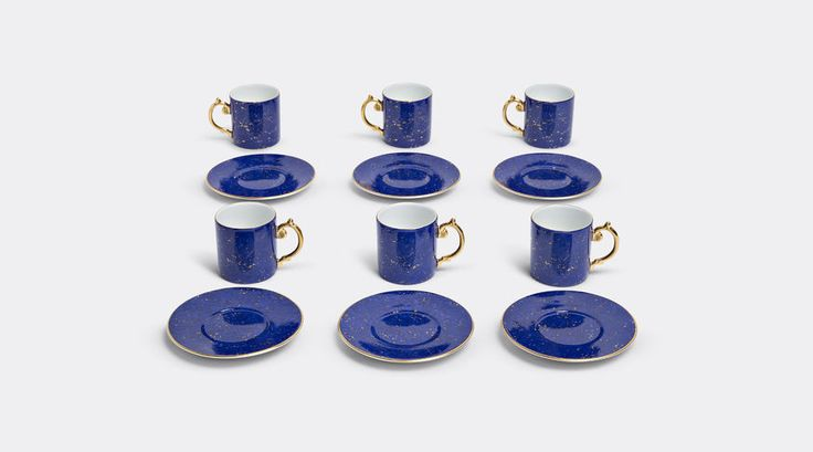 Lapis espresso cup + saucer (Gift box of 6) by L'Objet. When L'Objet's Elad Yifrach crafted this elegant azure espresso cup and saucer set he was inspired by the Mediterranean night sky. Made from Limoges porcelain and presented in a luxurious round gift box, all cups feature a 24 carat gold-covered handle, and that same hand-gilded gold is found on the rim of each item in the set, and delicately speckles every surface. Dishwasher safe. Shop it now at www.store.wallpaper.com