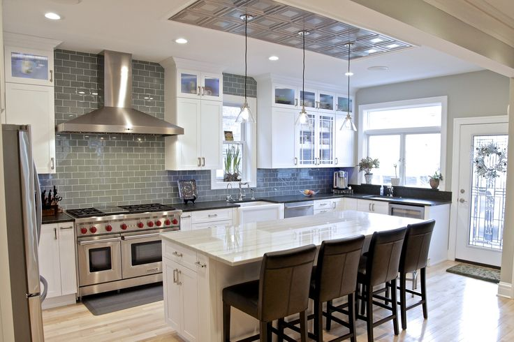 Kitchen Remodel by Budget Right Kitchens White Shaker Cabinets, Glass Tile, Kitchen Island, Led Cabinet Lighting