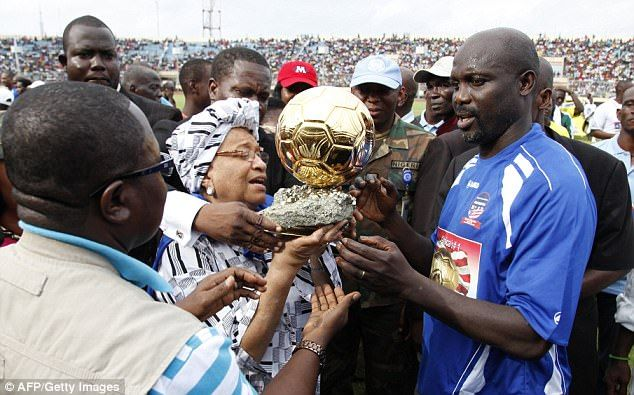 Weah shows off his Ballon d'Or trophy after winning the coveted award in 1995