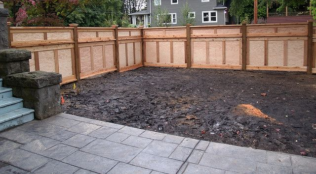 The owners of this high-end remodeled house didn't want any typical cedar fence.  With 6x6 posts and pressure-treated marine plywood, this fence is as durable as it is elegant.