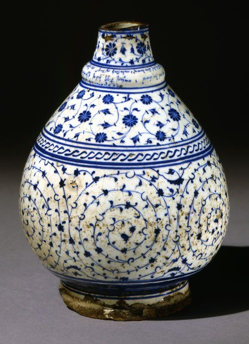 Bottle. Cut down, spiral scroll and cable band decoration. Armenian inscription on base and collar includes date. Made of blue, white painted and glazed ceramic, pottery.bottle; Ottoman dynasty; 18 March 1529; Iznik