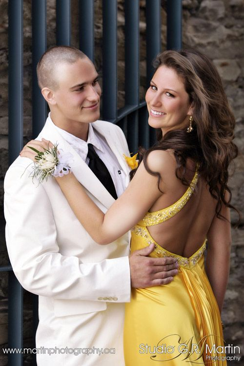 This, then have him kiss her on the cheek. (poses)  Also good if you have an interesting back on your dress