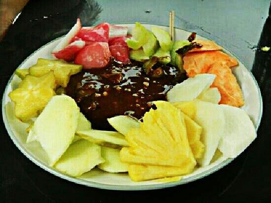 Rujak or fruits salad mix nron sugar & chilli. Fruits: star gruit, mango papaya guava pineapple cucumber