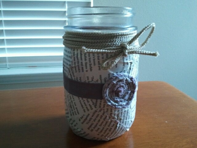 Took an old jar, decoupaged some magazine clippings, added a little fabric ribbon with rolled rosette flower (from an old tshirt).