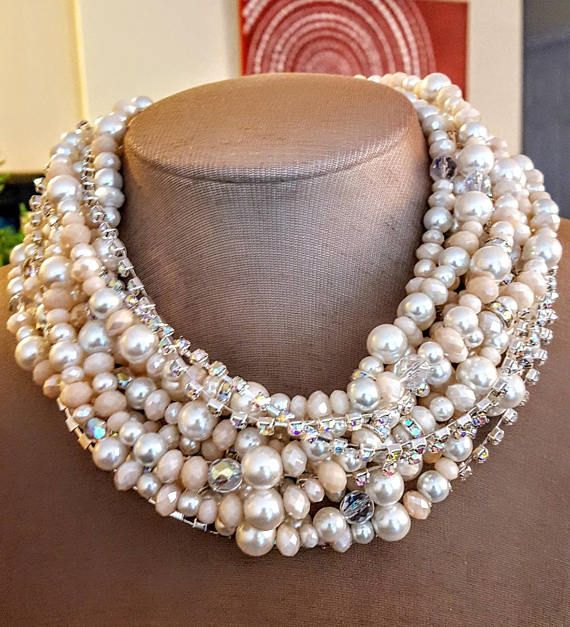 Check out this item in my Etsy shop https://www.etsy.com/ca/listing/534564393/blush-pink-pearl-and-crystal-multistrand