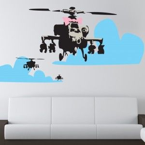 One of Banksy's more famous works, this will is entitled 'Happy choppers',  it features a 3 helicopters in a cartoon like sky, the front one has a big pink bow on it.  The Banksy Wall Decal is available in three sizes and can be bought in alternative colours. http://wowwalldecals.com.au/  #Wall Tattoos #Life quote wall stickers #Removable wall sticker quotes
