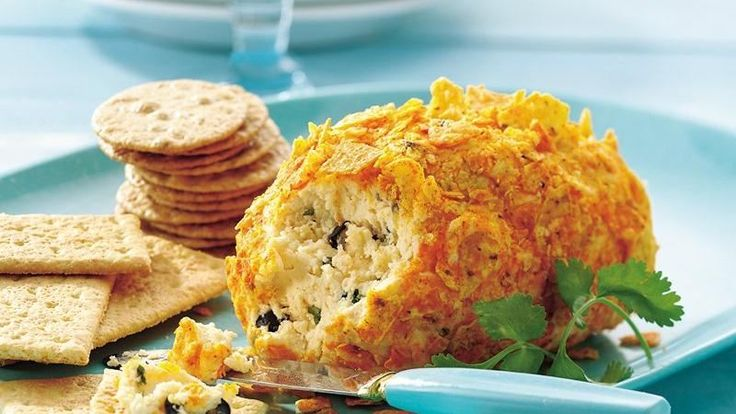 Spice up the appetizer table with this south-of-the-border take on a cheese ball. Pepper Jack cheese turns up the heat, cilantro and lime add fresh zest and a crushed tortilla-chip coating adds crunch.