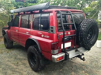 Nissan patrol rear door ladder by Overbuilt Accessories