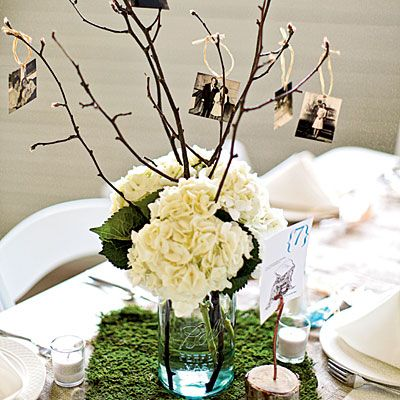 This clever design features pictures from throughout the guest of honor's life dangling from tree branches.  Although they use mason jars, which are adorable, you could use any type of vase or holder you'd like.