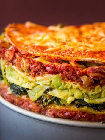 Layered Mexican nacho cake! Use tortillas for the layers.