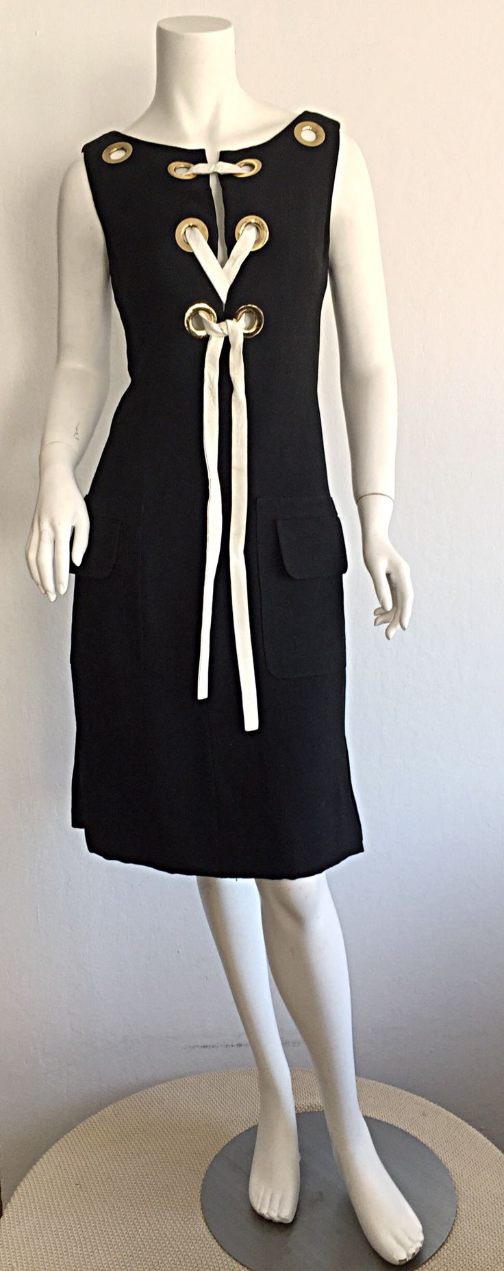 Rare 1960s Pierre Cardin Black Grommet Space Age Sheath Dress | From a collection of rare vintage evening dresses and gowns at https://www.1stdibs.com/fashion/clothing/evening-dresses/