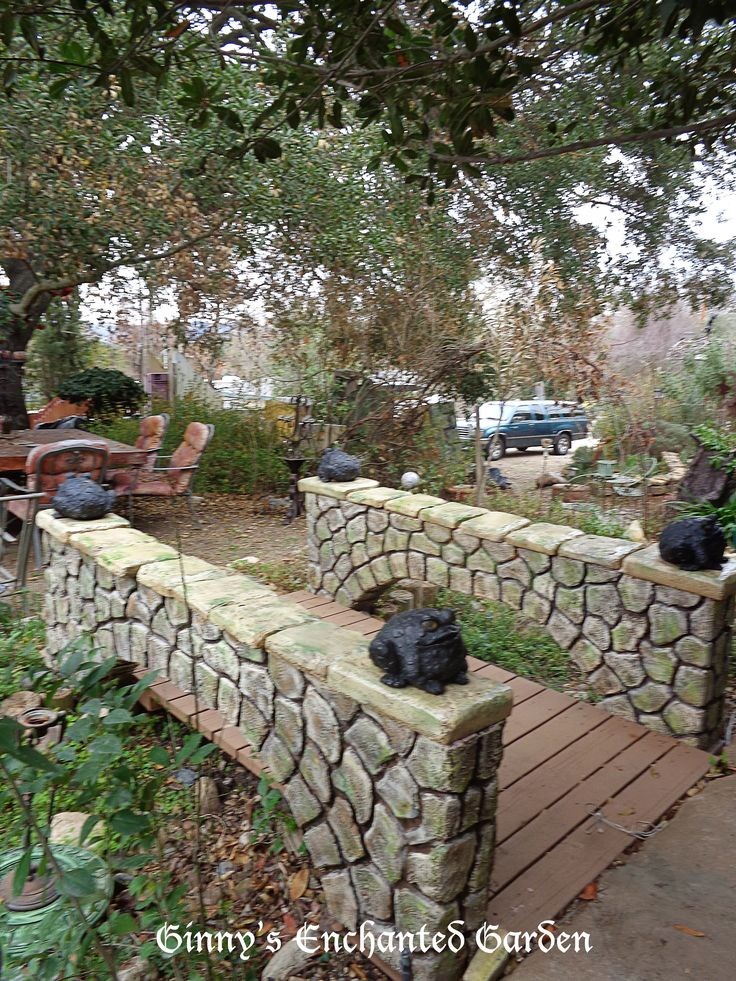 """My original bridge rotted after many years.  I replaced with a sculpted styrofoam bridge. It is made from 2"""" thick sheets of Owens Corning pink insulation foam and faux finished to look like stone.  The inside structure is an exterior grade plywood that is not exposed to the elements."""