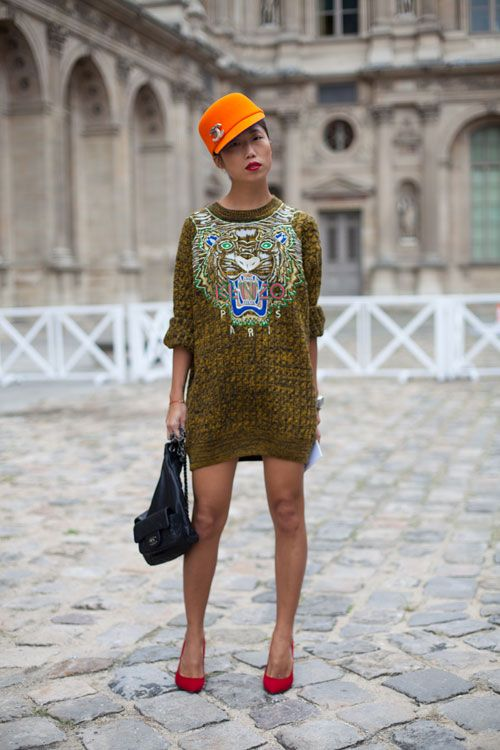 STREET STYLE SPRING 2013: PARIS FASHION WEEK - In a fun with fashion moment, this girl tips her orange hat to Chanel and Kenzo.