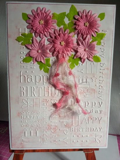Cuttlebug background {birthday) with pink flowers.