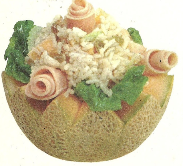 This looks like something that was picked out of the trash. Ham rolls, canteloupe, and maggoty looking rice. It goes deeper than the maggots. There's mayonnaise involved in this thing. (Family Circle Salad Cookbook, 1978)