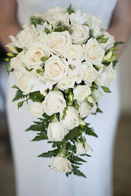 Elegant Cascading Bridal Bouquet Showcasing: White Roses, White Freesia, Evergreen & Green Leather Leaf Fern>>>>