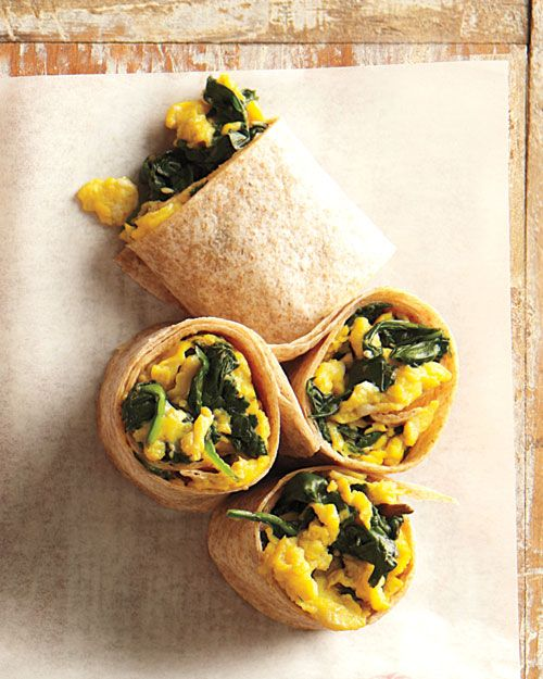 Scrambled Eggs with spinach in a whole wheat wrap. Very quick and simple, just had this for breakfast. Delicious!!