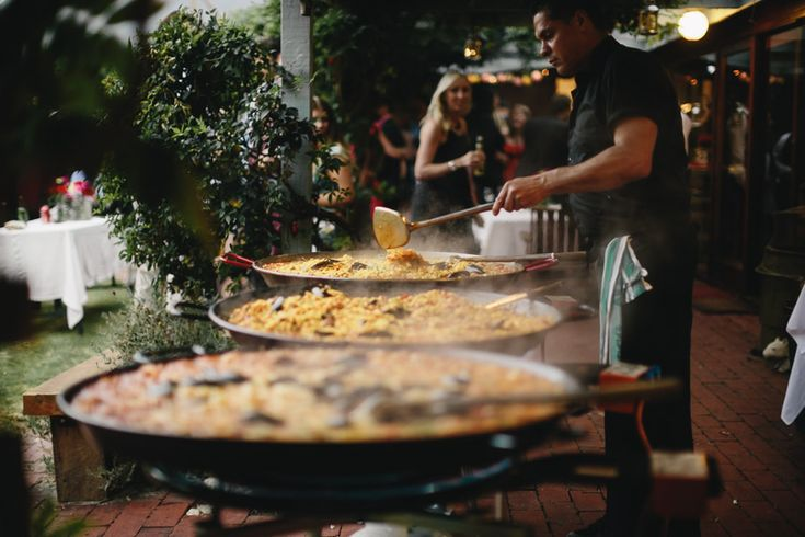 Giant vats of paella are so perfect for a relaxed outdoor wedding                                                                                                                                                                                 More