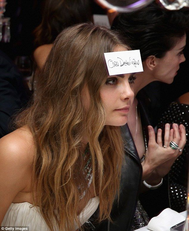 She's just SO wacky! Cara goes off-the-wall for a wacky stunt with her place card...