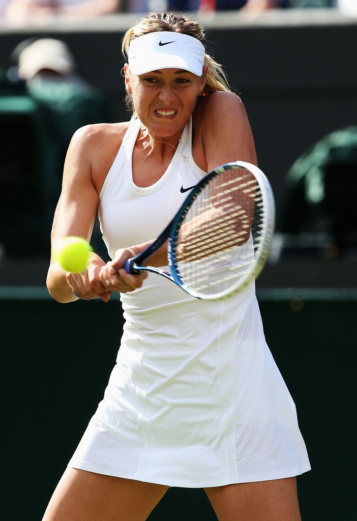 Maria Sharapova Photos: Wimbledon: Day 2. Maria Sharapova of Russia plays a backhand during her Ladies' Singles first round match against against Samantha Murray of Great Britain on day two of the Wimbledon Lawn Tennis Championships at the All England Lawn Tennis and Croquet Club at Wimbledon on June 24, 2014 in London, England.