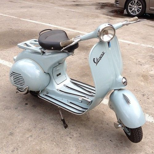 Light blue/green vespa