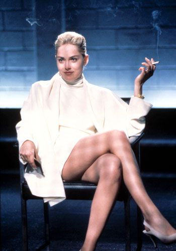 """Basic Instinct:    Sharon Stone's all-white outift in this unforgettable scene was made infamous by her character's absence of underwear.    FACT: The white dress was created from scratch by costume designer Ellen Mirojnick. Ellen stated in Clothes on Film she wanted to make the character of Catherine look like """"the icy blonde, similar to a Hitchcockian character""""."""