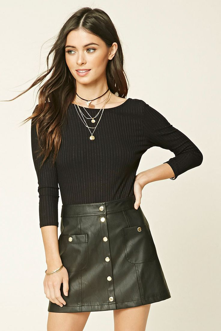 A faux leather mini skirt with a snap-buttoned front closure and two snap-buttoned patch pockets.