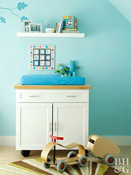 This petite nursery had no closet, but a transformed kitchen island on wheels provided a storage unit and changing table. Within the cabinets and drawers, smaller stackable bins keep everything organized. Wheel locks keep it in place.