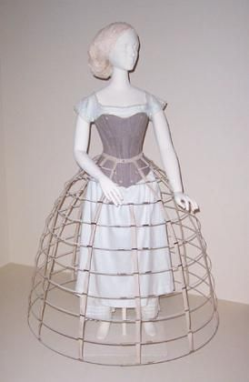 "This corset and hoop skirt were commissioned by the Boston Museum of Fine Arts for display in the 2004-05 textile department exhibit ""High Style and Hoop Skirts: Fashions of the 1850s"". They are based on primary source research found in museums, private collections, and period advertisements. The drawers and shift are authentic garments from the MFA collection. Star Rabinowitz : Corset, 1858"