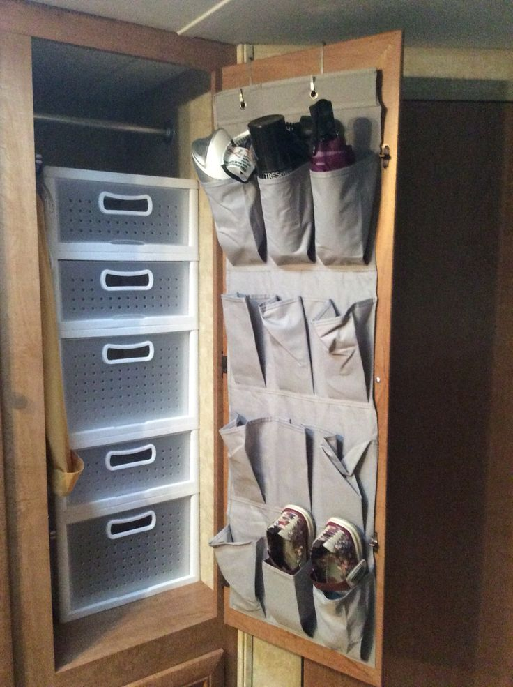 Storage solution... The kids closet has been a struggle in our camper.  I found these stacking drawers at Target and they were sold individually, so I could mix and match to make them fit. I then added an over the door shoe organizer (cut to fit the door and stapled to the door so it doesn't move) for shoes, but also additional storage like the hair dryer and umbrella.