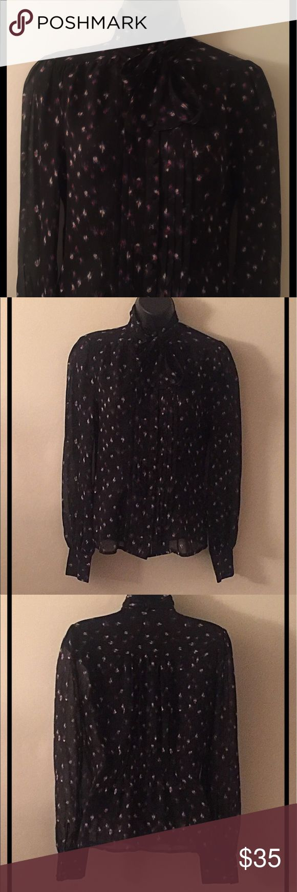 Bebe Silk Multi Color Blouse Bebe silk black multi-color long sleeve button down Blouse.  Perfect for any professional occasion.  Ties into a bow in front.  Size:  XS.  100% silk.  Absolutely gorgeous! bebe Tops Blouses