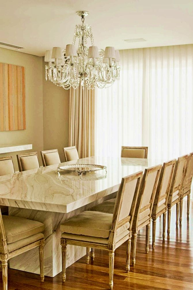chunky marble table + french dining chairs in a monotoned creamy palette