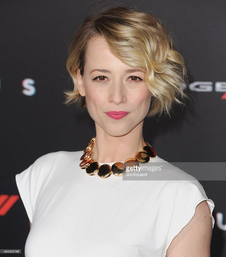 Actress Karine Vanasse arrives at the Los Angeles World Premiere Of Warner Bros. Pictures 'Focus' at TCL Chinese Theatre on February 24, 2015 in Hollywood, California.