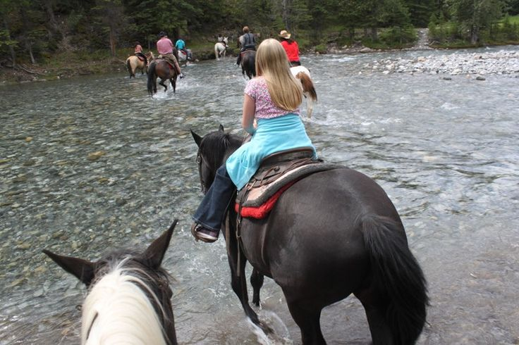 Horseback riding through Banff National Park. | 14 Sites In Alberta That Will Make You Feel Alive