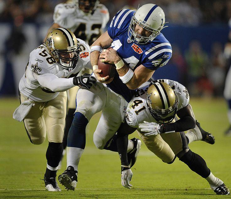 saints super bowl pictures | The Colts' Dallas Clark is tackled by the Saints' Scott Shanle (left ...