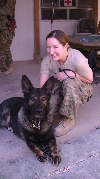 Nurse Capt. Allyson Dossman poses with Basco, a military working dog, at Forward Operating Base Lagman, Afghanistan, during her 2012-2013 deployment to the Miranda Trauma Center Forward Surgical Team. Now chief of the Yellow Ribbon Psychological Health Advocacy Program for Air Force Reserve Command, Dossman said research shows that petting a dog is linked to reduced blood pressure, lowered heart rate and an increased sense of well-being. (Courtesy photo)