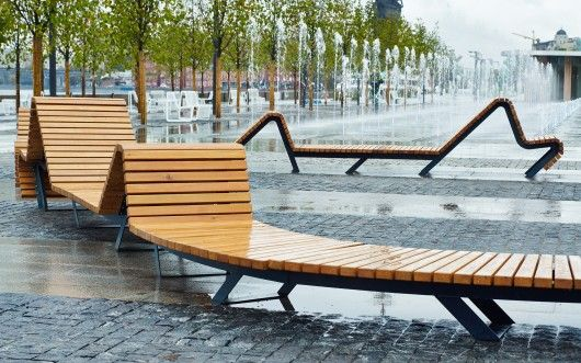 Creatively made playground in the back using fountains - and an untraditional bench in the front.