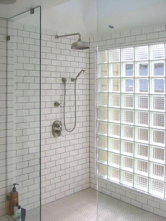 Subway tiles, industrial shower head, glass bricks.