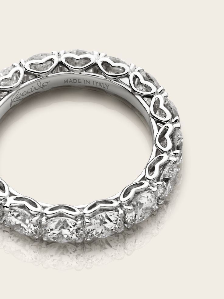 Hearts in the round decorate this unique eternity ring/band ... | Eternity Rings