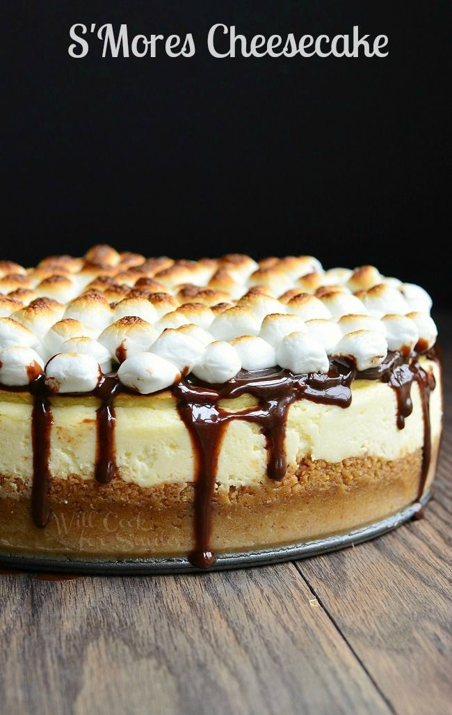 Amazing S'Mores Cheesecake. Smooth cheesecake made with a layer of chocolate and marshmallows on the bottom and topped with hot fudge sauce and toasted marshmallows.