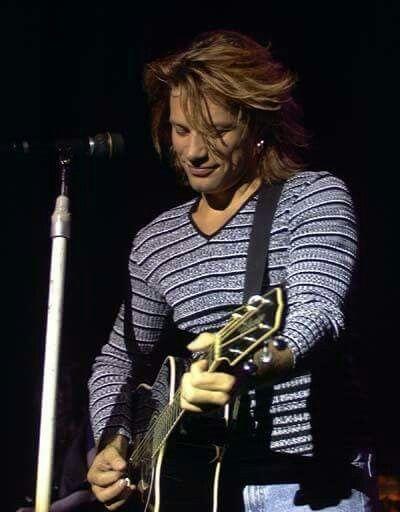 Jon Bon Jovi - playing his fav guitar in mid-1990's