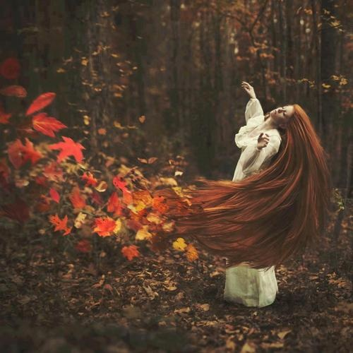 she waves her hair and leaves fall