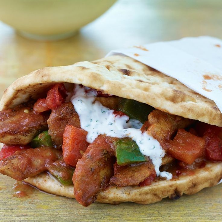 A classic Indian chicken and bell pepper dish gets a modern food truck makeover. Serve as a handheld sandwich wrapped in naan and topped with a minty yogurt sauce to ignite all of the senses.