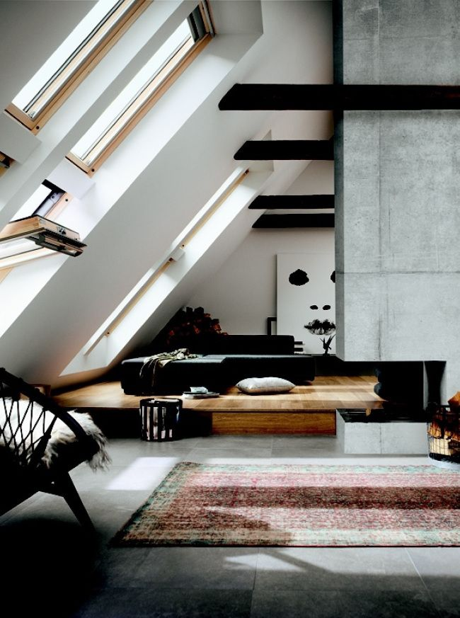 Angular light; good use of vaulted ceilings and beams to create a trapezoidal repetition throughout. Like the tones of white, grey and black.