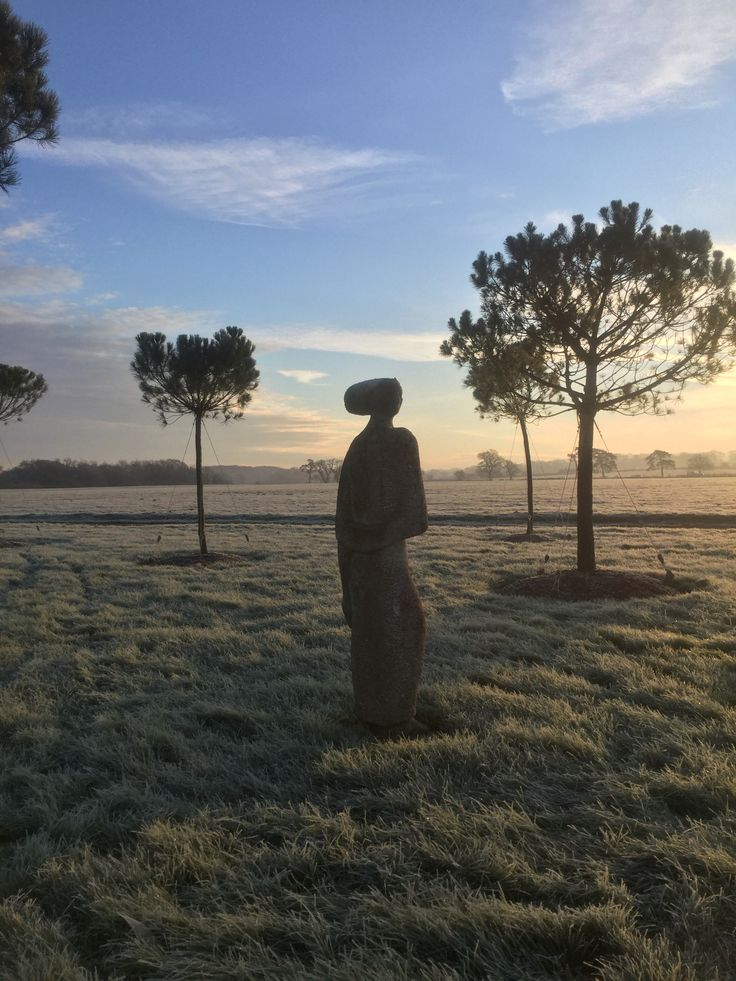 The Stone Lady looking out over a frosty field at our nursery near Pulborough